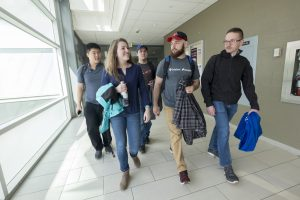 A group of students walking down the halls at the Barrie Campus